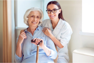caregiver holding the shoulder of elderly patient